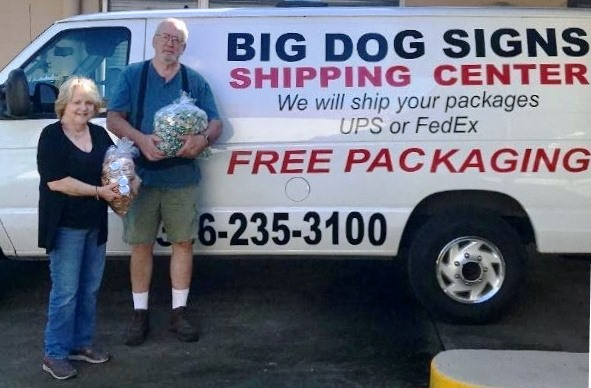 Big Dog Signs & Graphics Provides Work Contract